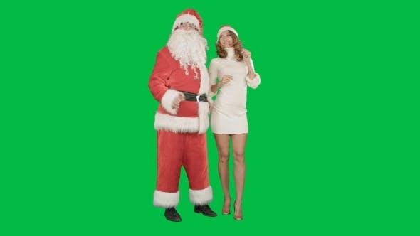 Thumbnail for Christmas Happy Smile Girl Dancing With Santa