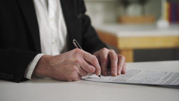 Thumbnail for Businessman Signs Documents