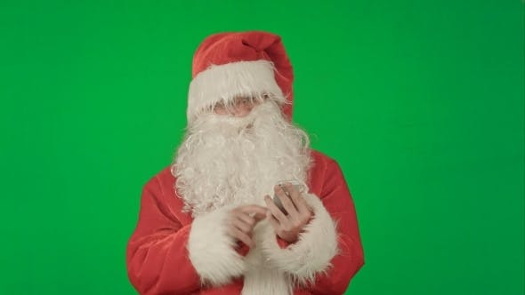 Thumbnail for Santa Claus Reads And Sends Text Messages From His