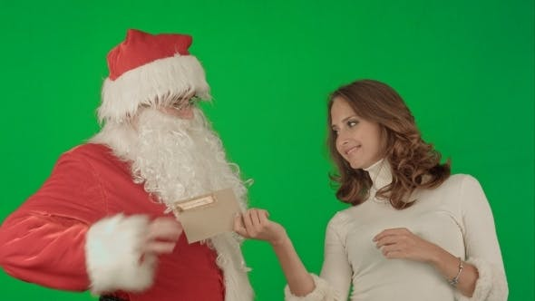 Thumbnail for Happy Santa Claus With His Woman Helper Reading