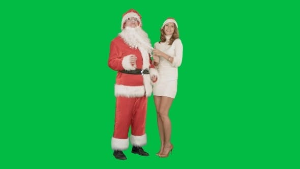 Thumbnail for Beautiful Happy Woman Dancing With Santa Claus