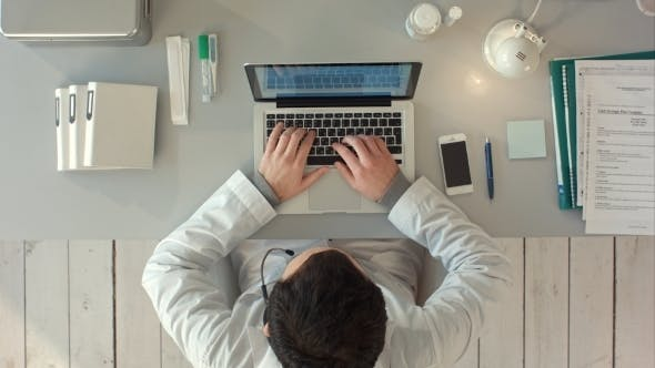 Thumbnail for Top View Of Medical Worker With Laptop