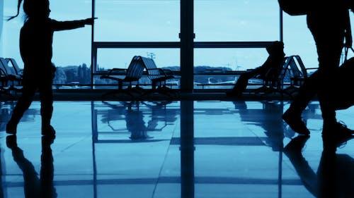 Unrecognizable Silhouettes of Passengers