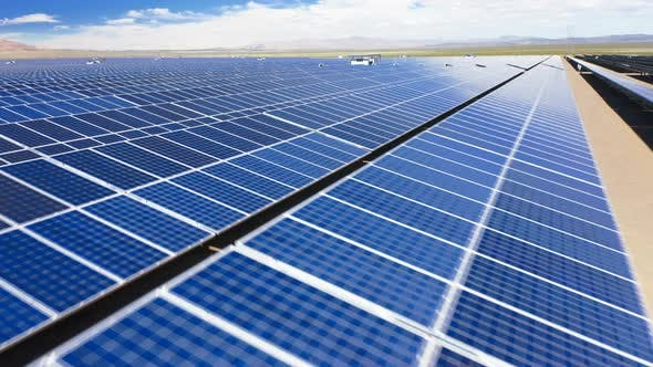 Thumbnail for Drone Flight Close To the Surface of Solar Panels Arranged in Long Rows at the Solar Farm in Nevada