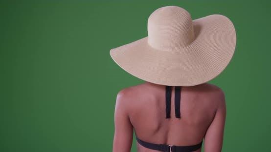 Thumbnail for African American woman in a sunhat in her bikini on green screen