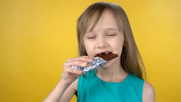 Cover Image for Cute Little Girl Eating Chocolate