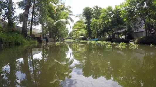 Thumbnail for Boat Across Rainforest