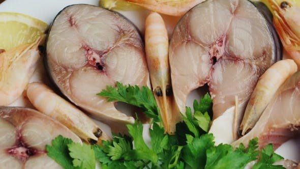 Thumbnail for Appetizing Pieces Of Fish With Herbs And Lemon