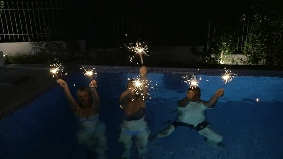 Thumbnail for Family Or Friends With Bengal Lights In The Pool