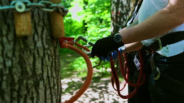 Thumbnail for Rope Adventure - Man Attaching His Insurance Belt To the Rope