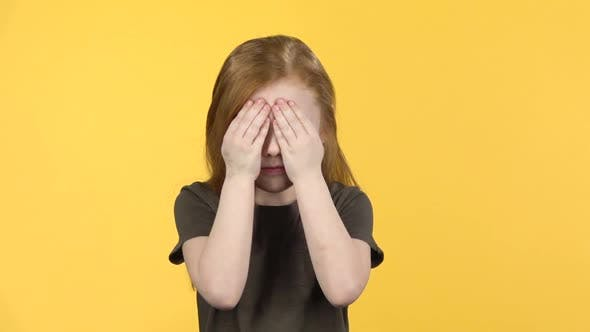 Thumbnail for Cute Child with Red Hair Have Fun Covers Her Face with Hands. Slow Motion