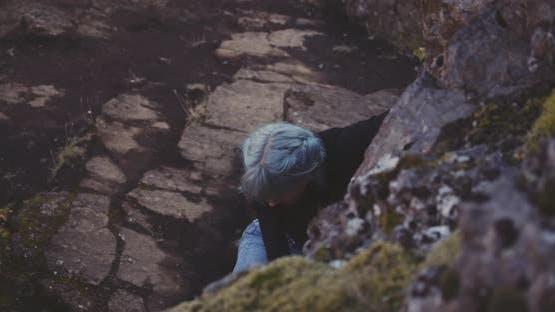 Boulderer Climbing Rocks In Iceland