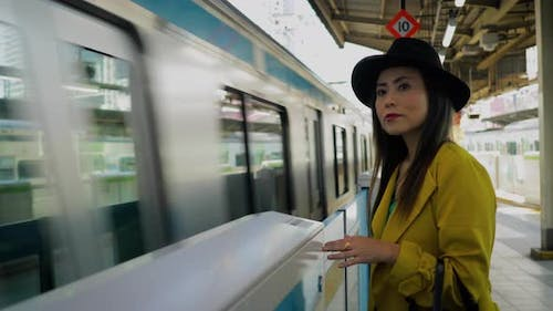 Japanese woman waiting for a train in Tokyo Japan