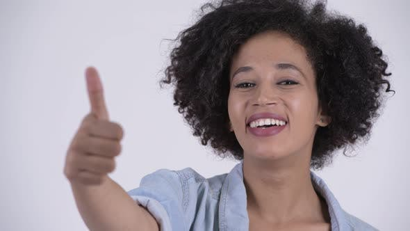 Thumbnail for Face of Young Happy African Woman Giving Thumbs Up