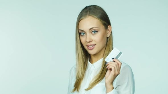 Thumbnail for Woman Chooses Between a Credit Card And Cash
