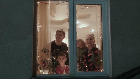 Thumbnail for Christmas, Happy Family Near a Window