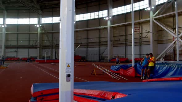 Thumbnail for Pole Vaulting - Young and Beautiful Sportswoman in Gray t Shirt Is Running Jumping Over the Bar
