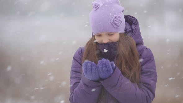 Thumbnail for Little Girl Hat Catching Snowflakes In Winter Park
