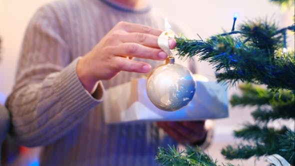 Thumbnail for Male Hanging Balls On The Christmas Tree