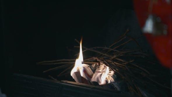 Thumbnail for Man Lighting Fire