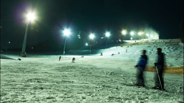 Thumbnail for Night Skiing At The Ski Slopes And Snow Cannons