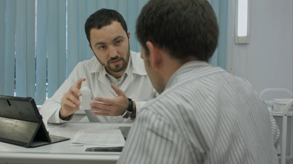 Thumbnail for Male Bearded Doctor In Clinic Offer Medicine To