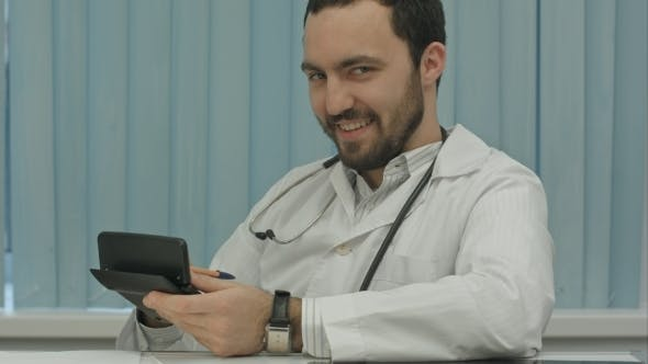 Sinister Bearded Doctor With a Calculator