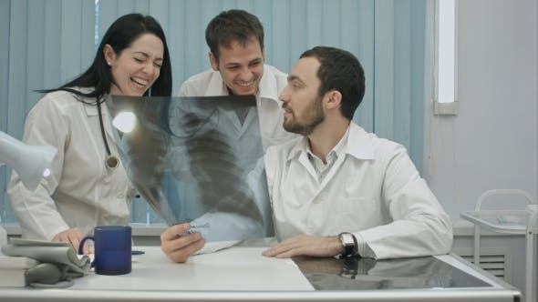 Thumbnail for Laughing Doctors Studying X-ray