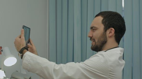 Thumbnail for Male Doctor Taking Selfie, Smiling