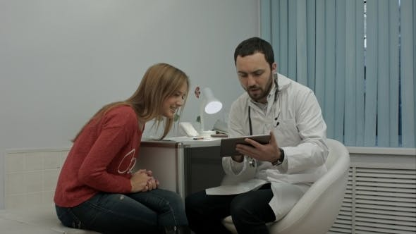 Thumbnail for Male Bearded Doctor Consult Client With Tablet Pc.