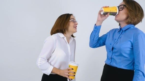 Thumbnail for Businesswomen On Coffee Break Telling Funny