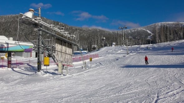 Thumbnail for Skiers And Snowboarders Are Riding On Downhill