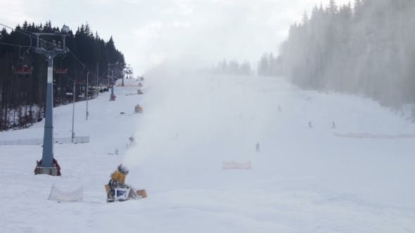 Thumbnail for Skiers Ride On The Ski Slopes And Snow Cannons
