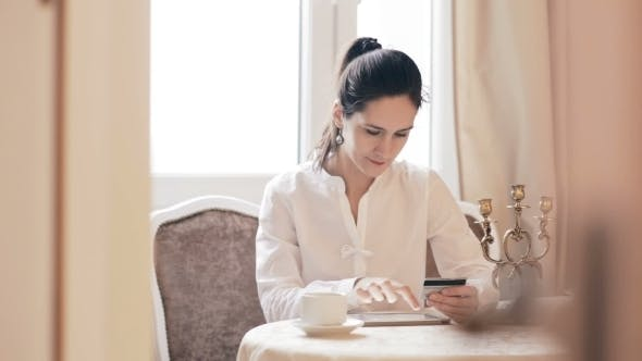 Thumbnail for Woman Shopping Online With Tablet Computer