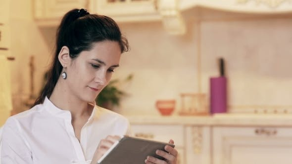 Thumbnail for Woman Shopping Online With Tablet. Through Glass