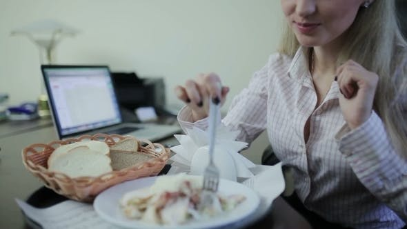 Thumbnail for Businesswoman Eating At The Workplace