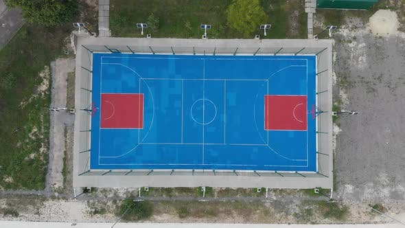 Aerial vertical shot of basketball court.