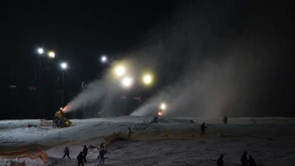 Thumbnail for Skiers Ride On The Ski Slopes And Snow Cannons.