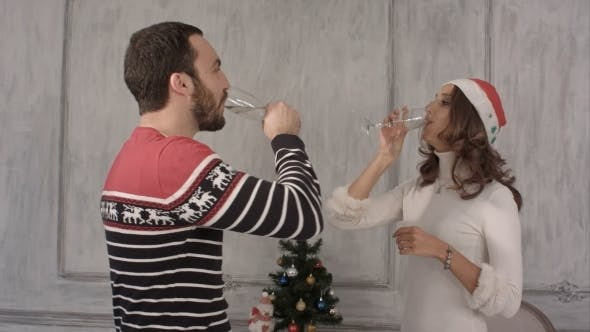 Thumbnail for Couple Holding Champagne While Dancing