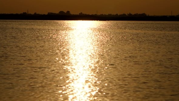 Cover Image for Reflection Of The Sun On River