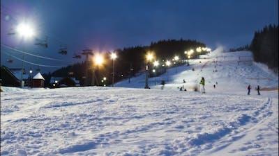 Night Skiing At The Ski Slopes.