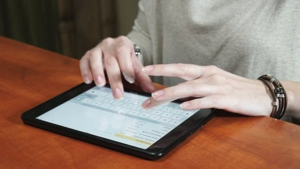 Thumbnail for Woman Hands Working On Tablet Computer In Office