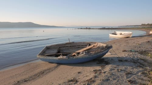 Empty Small Wooden Boats On The Beach