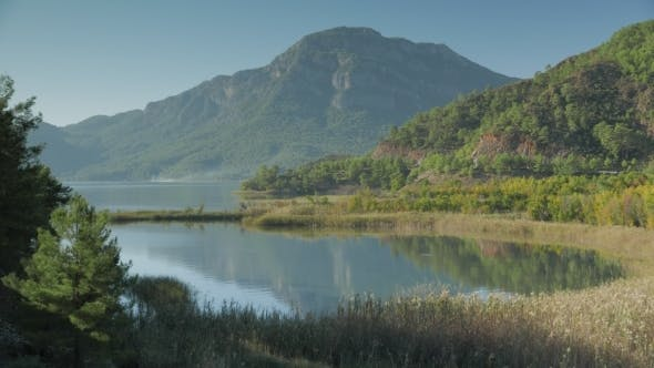 Thumbnail for View Of Lake, Bay With Dried Grass, Green Mountain
