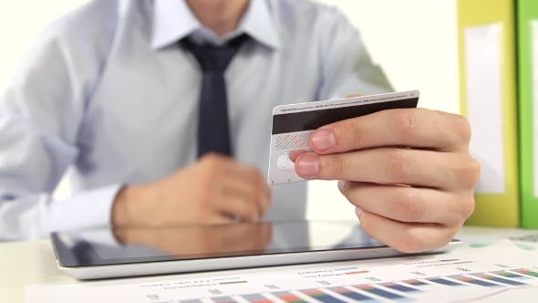 Thumbnail for Businessman Paying With Credit Card By Tablet