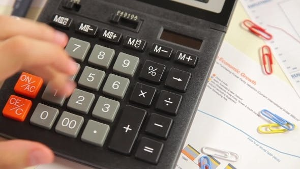Thumbnail for Businessman Counting On a Calculator