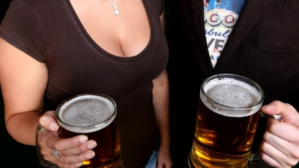 Thumbnail for Two Friends Cheer Beer In Bar