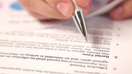 Businessman Working With Rental Contract