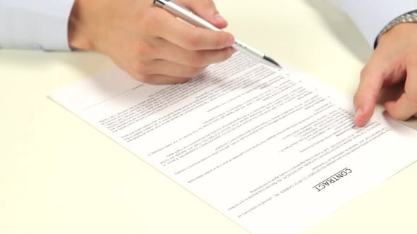 Thumbnail for Businessman Reads And Sign a Contract