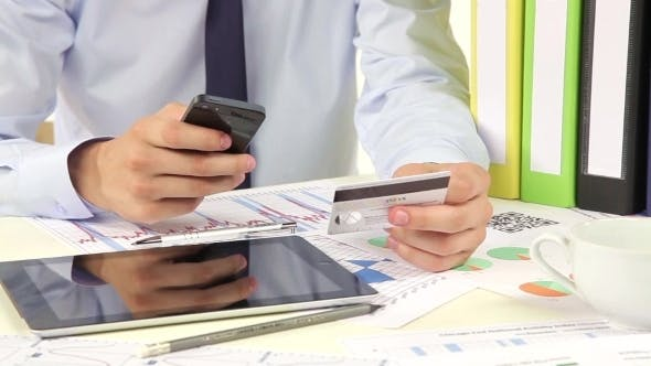 Thumbnail for Businessman Paying With Credit Card By Mobile